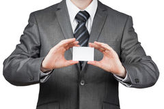Businessman With  Business Card. Serious Businessman  Holds A Business Card With Two hands Royalty Free Stock Image