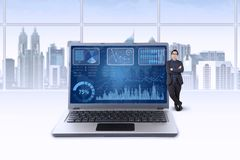 Businessman and business chart on laptop screen Royalty Free Stock Photography