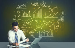 Businessman with business diagrams Stock Photos