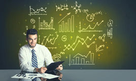 Businessman with business diagrams Stock Photography