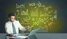 Businessman with business diagrams Royalty Free Stock Photos
