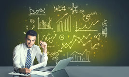 Businessman with business diagrams Stock Photo