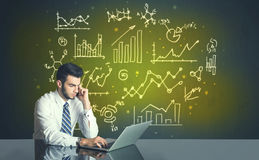 Businessman with business diagrams Royalty Free Stock Photography