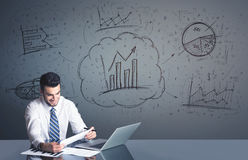 Businessman with business diagrams Stock Image
