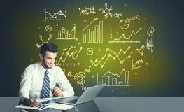 Businessman with business diagrams Stock Images