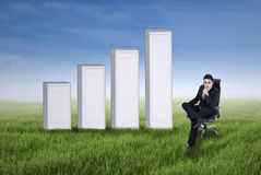 Businessman with business growth chart Stock Photo
