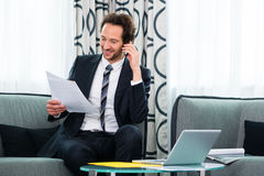 Businessman in business hotel is on the phone Royalty Free Stock Photo