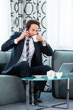 Businessman in business hotel is on the phone Stock Photo