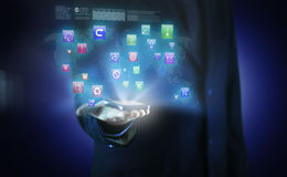 A businessman with business icons in a hologram Stock Images