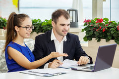 Businessman and business lady at a meeting. They are discussing the contract. Royalty Free Stock Photo