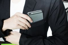 Businessman. Business Man holding a credit Working With Modern Devices, Digital Computer And Mobile Phone(Vintage royalty free stock photo