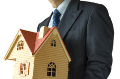 Businessman. Business man with house model on hand- real estate concept Royalty Free Stock Images