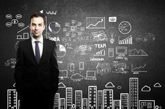 Businessman and business plan Stock Photo
