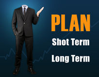 Businessman with business plan shot term and long term.  Stock Photo
