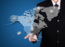 Businessman business present on north america map. Blue background royalty free stock image