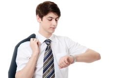 The businessman in a business suit looks at watch Stock Photography