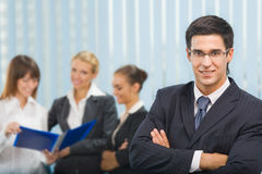 Businessman and business team Stock Images