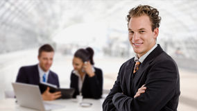 Businessman and business team stock photos