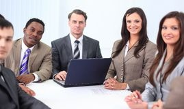 Businessman and business team sitting at Desk Stock Photography