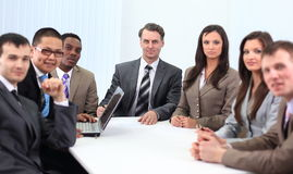 Businessman and business team sitting at Desk Royalty Free Stock Photos