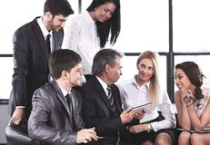 Businessman and business team using digital tablet stock photography