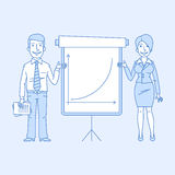 Businessman and business woman point to flip chart Stock Images