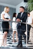 Businessman and business woman standing on the terrace of the office. Royalty Free Stock Photography