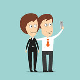 Businessman and business woman taking selfie Stock Image