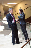 Businessman and business woman talking Royalty Free Stock Photos