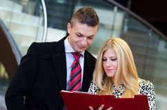 Businessman and business woman talking over documents Royalty Free Stock Photo