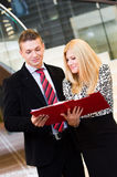 Businessman and business woman talking over documents Royalty Free Stock Photography