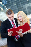 Businessman and business woman talking over documents Royalty Free Stock Images