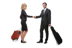 Businessman and business woman with travel cases Royalty Free Stock Image