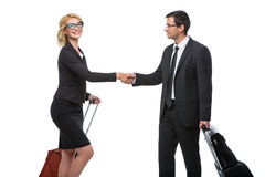 Businessman and business woman with travel cases Stock Photography