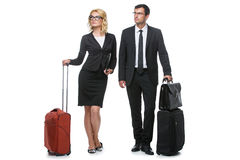 Businessman and business woman with travel cases Stock Image