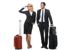 Businessman and business woman with travel cases Stock Images