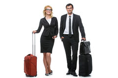 Businessman and business woman with travel cases Royalty Free Stock Photo