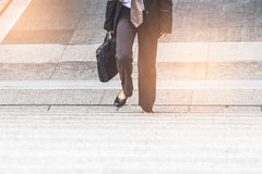 Businessman and Business woman up the stairs. In a rush hour to work Royalty Free Stock Images
