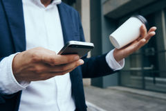 Businessman, businessman with phone, businessman holding coffee.  Royalty Free Stock Photo