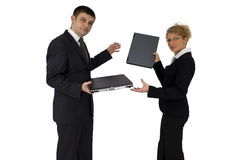 Businessman and businesswoman. Businessman and businesswoman exchange their laptops Stock Photography