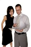 Businessman and businesswoman are analysing document Stock Photography