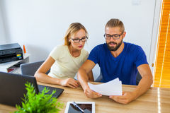 Businessman and businesswoman analyzing some documents. Business Royalty Free Stock Images