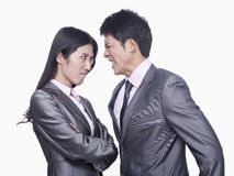 Businessman and businesswoman angry at each other, studio shot Stock Photo