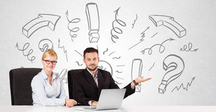 Businessman and businesswoman brainstorming with drawn arrows an Royalty Free Stock Photos