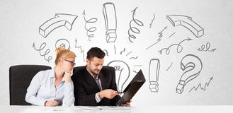 Businessman and businesswoman brainstorming with drawn arrows an Royalty Free Stock Image