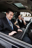 Businessman and Businesswoman in a Car Royalty Free Stock Photography