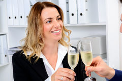 Businessman and businesswoman celebrating  together in the offic Stock Photos