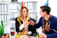 Businessman and businesswoman celebrating  together in the offic Royalty Free Stock Image