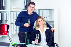 Businessman and businesswoman celebrating  together in the offic Royalty Free Stock Photos