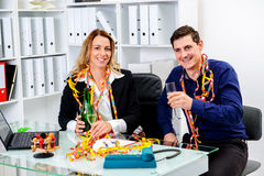 Businessman and businesswoman celebrating  together in the offic Stock Photo
